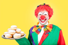 Clown with berlin pancakes Royalty Free Stock Photography