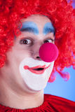 Clown on blue backgound Stock Photos
