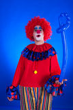 Clown on blue backgound Royalty Free Stock Photos