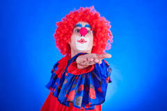 Clown on blue backgound Royalty Free Stock Photo