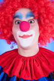 Clown on blue backgound Stock Photo