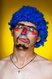 Clown in a blue wig Royalty Free Stock Photography