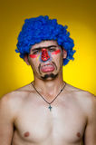 Clown in a blue wig Royalty Free Stock Image