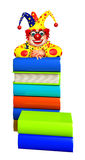 Clown with Book stack. 3d rendered illustration of Clown with Book stack Royalty Free Stock Images