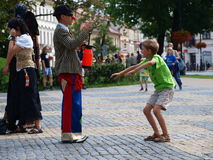 Clown with a boy, Lublin, Poland. Clown with a boy during the annual Jagiellonian Fair (12th-14st August 2011), Lublin, Poland, August 13th 2011 Royalty Free Stock Photos