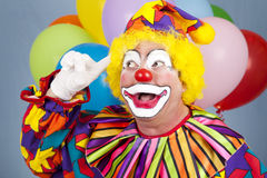 Clown With Bright Idea. Portrait of a birthday clown with a bright idea Stock Images