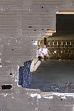 Clown in broken wall. Clown in abandoned house door, fear and halloween stock photos