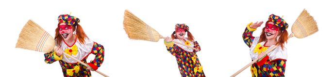 Clown with broom isolated on white. The clown with broom isolated on white royalty free stock photos