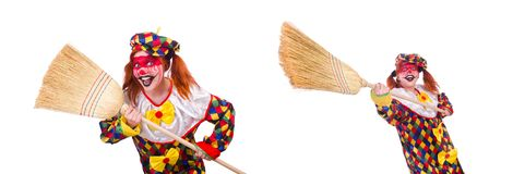 The clown with broom isolated on white. Clown with broom isolated on white royalty free stock photo