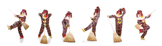The clown with broom isolated on white. Clown with broom isolated on white royalty free stock images