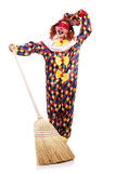 Clown with broom Royalty Free Stock Image
