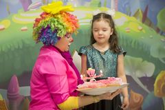 The clown brought a birthday cake. royalty free stock photography