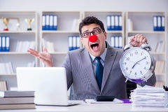 The clown businessman with alarm clock missing dieadline Royalty Free Stock Photo