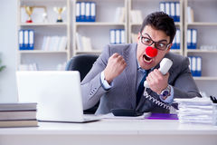 The clown businessman angry frustrated working in the office. Clown businessman angry frustrated working in the office Royalty Free Stock Photo