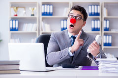 The clown businessman angry frustrated working in the office. Clown businessman angry frustrated working in the office Royalty Free Stock Photos