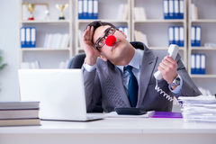 The clown businessman angry frustrated working in the office. Clown businessman angry frustrated working in the office Stock Photography