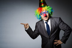 Clown businessman. In funny concept stock photo