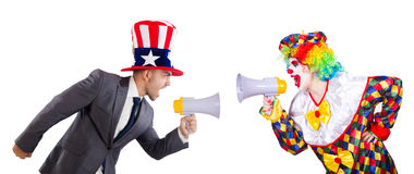 The clown and businessman holding loudspeakers Stock Photography