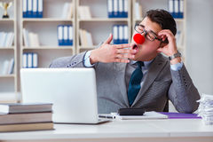 The clown businessman tired sleepy in the office Stock Image
