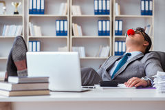 The clown businessman tired sleepy in the office Royalty Free Stock Photography