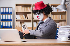 The clown businessman working in the office Stock Image