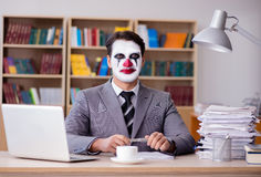 The clown businessman working in the office Royalty Free Stock Photo
