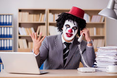 The clown businessman working in the office Stock Images