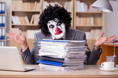 The clown businessman working in the office Stock Photos