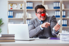 Clown businessman working  in the office. Clown businessman working in the office Royalty Free Stock Photography