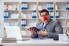 The clown businessman working in the office. Clown businessman working in the office Royalty Free Stock Photo
