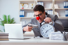Clown businessman working in the office angry frustrated with a Royalty Free Stock Image