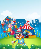 A clown at the carnival with balloons. Illustration of a clown at the carnival with balloons Royalty Free Stock Images