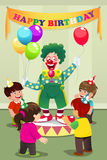 Clown carrying balloons to kids birthday party Royalty Free Stock Images