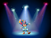 A clown at the center of the stage Stock Images