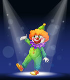 A clown at the center of the stage with a spotlight Royalty Free Stock Image