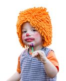 Clown child eating a lollipop on white background. Portrait of cute clown child eating a lollipop isolated on white background royalty free stock photos