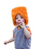 Clown child eating a lollipop on white background Stock Photo