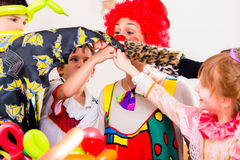 Clown at children birthday party with kids Stock Images