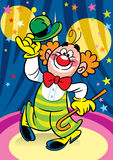 Clown in the circus. Funny clown performs at the circus arena Stock Photo