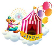 A clown beside a circus tent with balloons. Illustration of a clown beside a circus tent with balloons on a white background Royalty Free Stock Image