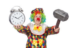 Clown with clock and hammer isolated on white Royalty Free Stock Photography