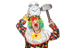 Clown with clock and hammer isolated on white Stock Image