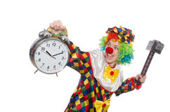 The clown with clock and hammer isolated on white Royalty Free Stock Photos