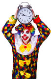 Clown with clock Stock Photo