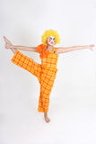 Clown in colourful costume doing gymnastic Royalty Free Stock Images