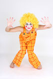 Clown in colourful costume showing hands Stock Images