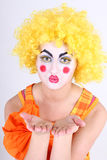 Clown in colourful costume showing hands Royalty Free Stock Photos