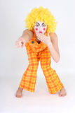 Clown in colourful costume showing something Royalty Free Stock Photography