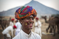 A clown. Is a comic performer who employs slapstick or similar types of physical humour performing in pushkar camel fair 2015 Stock Photos