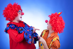 Clown couple on blue background Stock Photos
